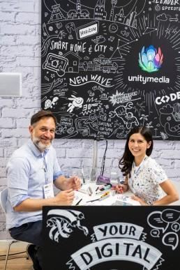 Live Zeichnen auf einem MessestandKunde: Unitymedia Event: ANGA COM 2019, Stephan Lomp wurde unterstützt von Lisa Taniyama (Studio Rabotti).
